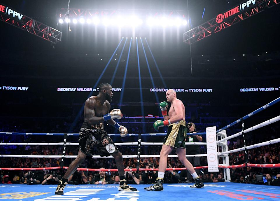 LOS ANGELES, CA - DECEMBER 01:  Tyson Fury and Deontay Wilder in the first round, fighting to a draw during the WBC Heavyweight Championship at Staples Center on December 1, 2018 in Los Angeles, California.  (Photo by Harry How/Getty Images)
