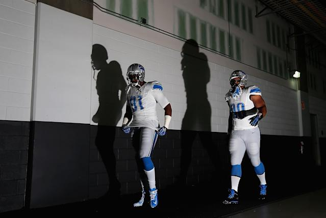 GLENDALE, AZ - SEPTEMBER 15: Defensive end Jason Jones #91 and defensive tackle Ndamukong Suh #90 of the Detroit Lions walk out to the field before the NFL game against the Arizona Cardinals at the University of Phoenix Stadium on September 15, 2013 in Glendale, Arizona. (Photo by Christian Petersen/Getty Images)