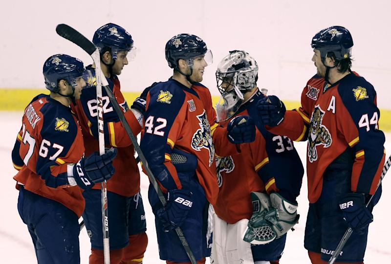 Florida Panthers' Erik Gudbranson (44), who scored two goals, celebrates with his teammates Vincent Trocheck (67), Mike Caruso (62), Quinton Howden (42), and Rob Madore (33) after the Panthers defeated the Nashville Predators 6-3 during an NHL preseason hockey game, Monday, Sept. 16, 2013, in Sunrise, Fla. (AP Photo/Lynne Sladky)