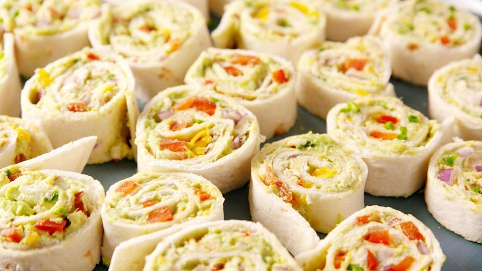 """<p>These chicken avocado salad pinwheels double as a nutritious lunch and an adorable party appetizer.</p><p>Get the recipe from <a href=""""https://patty-delish.hearstapps.com/cooking/recipes/a52540/chicken-avocado-roll-ups/"""" rel=""""nofollow noopener"""" target=""""_blank"""" data-ylk=""""slk:Delish"""" class=""""link rapid-noclick-resp"""">Delish</a>.</p>"""