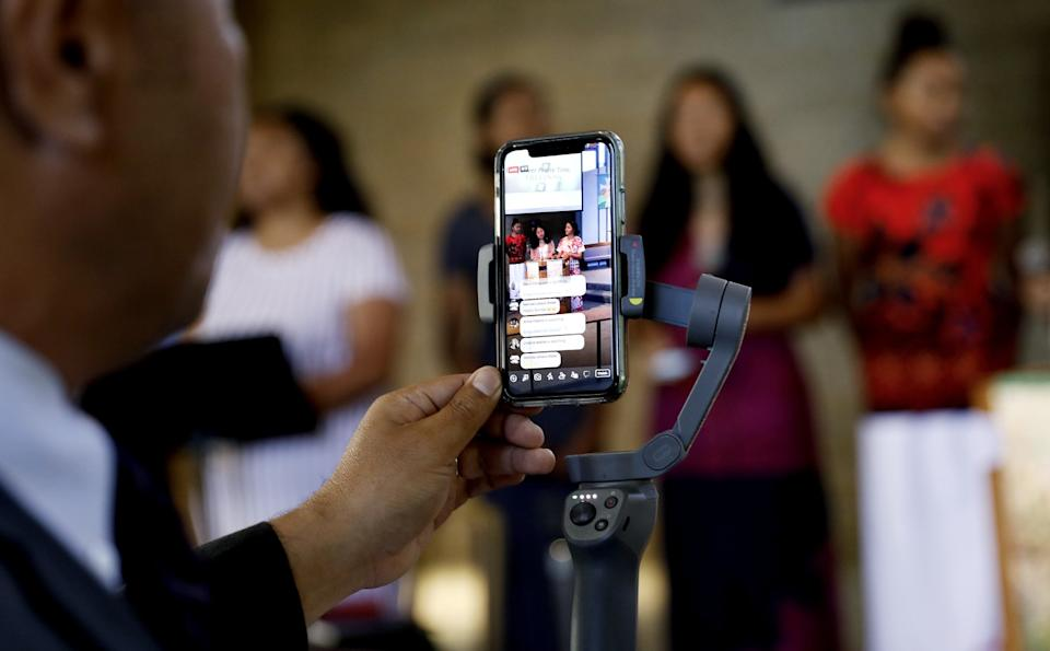 """Pastor Kitione Tuitupou, left, livestreams services from inside First United Methodist Church of Bellflower, whose congregation of about 100 is majority Tongan. <span class=""""copyright"""">(Christina House / Los Angeles Times)</span>"""