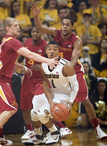 Missouri's Phil Pressey, center, looks for help as Iowa State's Scott Christopherson, left, Chris Allen, right, and Melvin Ejim, rear, defend during the first half of an NCAA college basketball game Wednesday, Feb. 29, 2012, in Columbia, Mo. (AP Photo/L.G. Patterson)