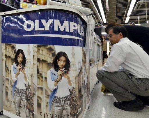 Japan's Sony is to inject about $623 million into troubled Olympus