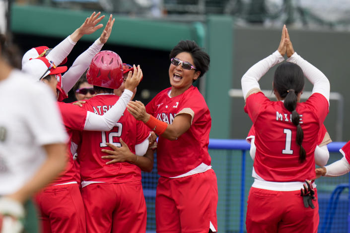 Japan players celebrate their win over Mexico during their softball game at the 2020 Summer Olympics, Thursday, July 22, 2021, in Fukushima , Japan. (AP Photo/Jae C. Hong)