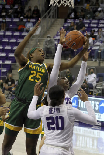 Baylor center Queen Egbo (25) and TCU guard Aahliyah Jackson (1) try for the rebound during the first half of an NCAA college basketball game, Saturday, Jan. 2, 2021. (AP Photo/ Richard W. Rodriguez)