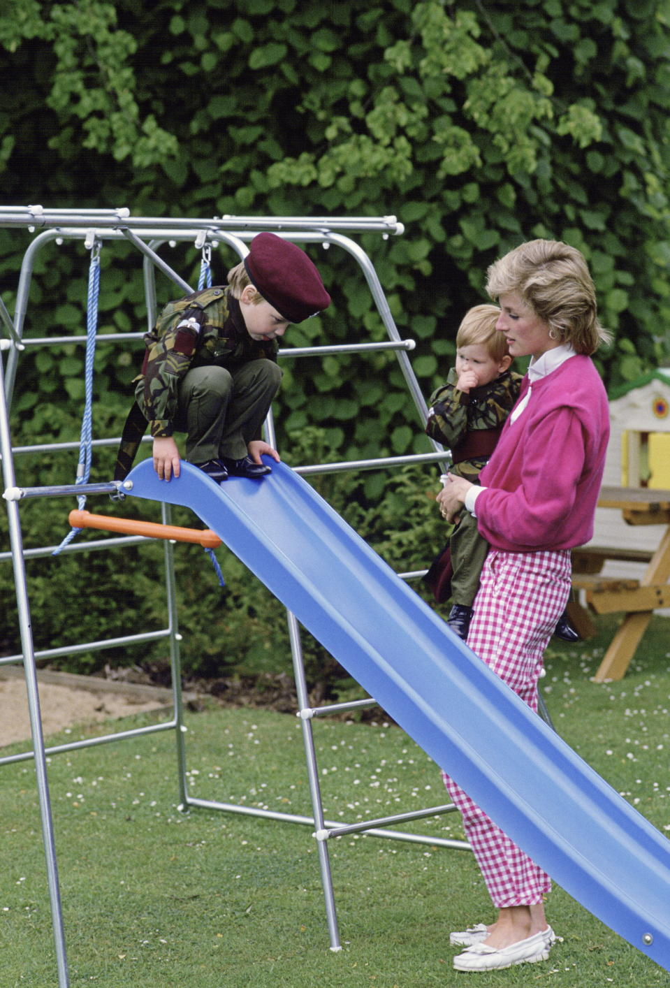 TETBURY, UNITED KINGDOM - JULY 18:  Princess Diana With Her Sons, William And Harry As They Play On A Slide In The Grounds Of Highgrove.  (Photo by Tim Graham Photo Library via Getty Images)