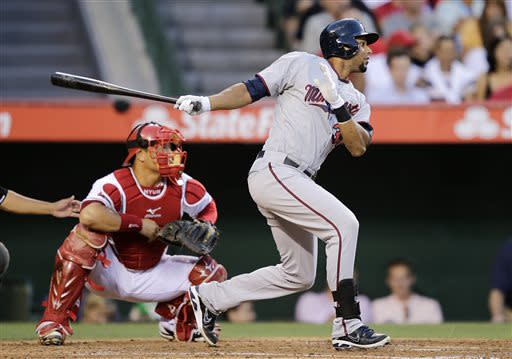 Minnesota Twins' Aaron Hicks hits an RBI double during the second inning of a baseball game against the Los Angeles Angels on Monday, July 22, 2013, in Anaheim, Calif. (AP Photo/Jae C. Hong)