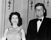 FILE - This is a June 5, 1961 file photo of Queen Elizabeth II and U.S. President John Kennedy as they pose at Buckingham Palace in London. The Kennedy's were dinner guests of the Queen. (AP Photo, File)