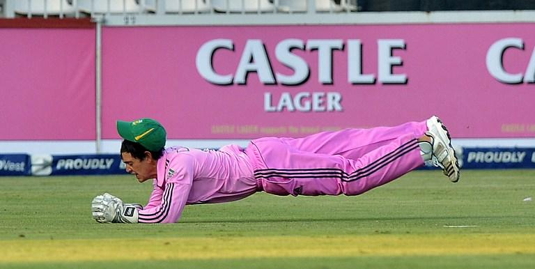 South Africa's Quinton de Kock catches India's cricketer Shikhar Dhawan  during the first one-day Internationals (ODI) match between South Africa and India at the Wanderers Stadium in Johannesburg, on December 5, 2013. AFP PHOTO / ALEXANDER JOE