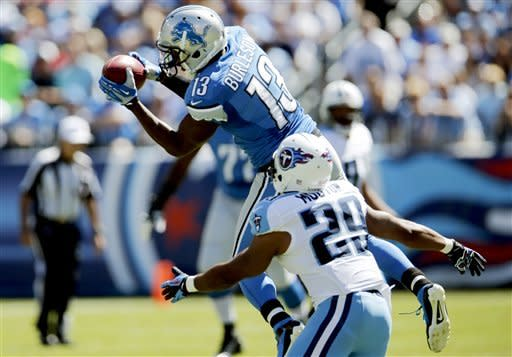 Detroit Lions wide receiver Nate Burleson (13) catches a pass as he is defended by Tennessee Titans cornerback Ryan Mouton (29) in the first quarter of an NFL football game, Sunday, Sept. 23, 2012, in Nashville, Tenn. (AP Photo/Joe Howell)