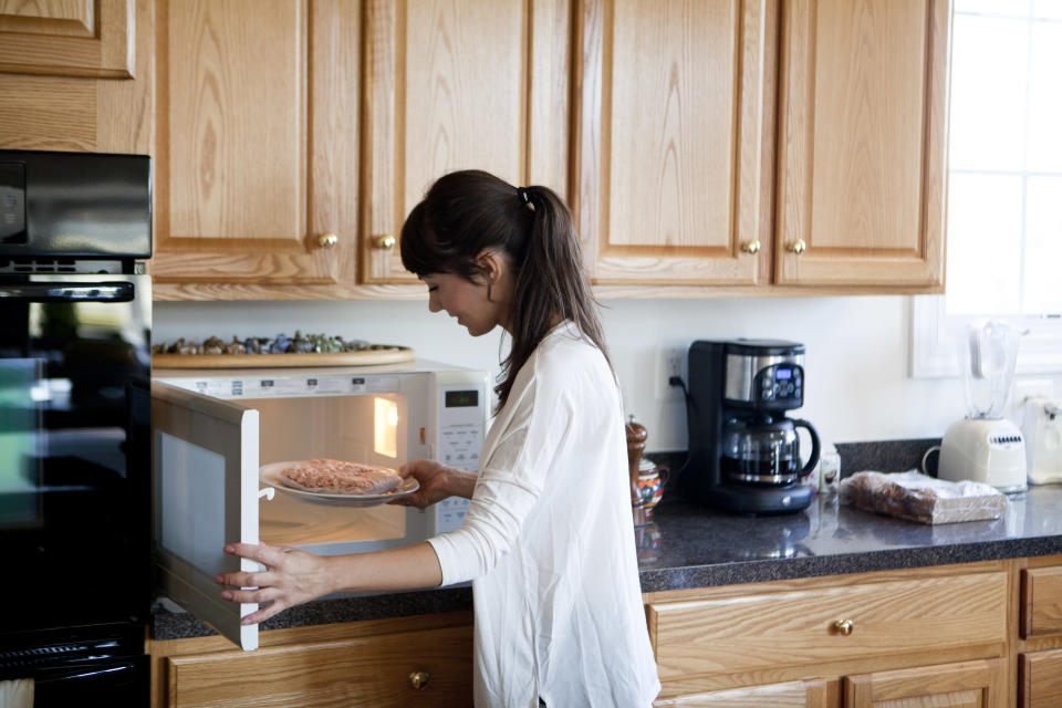 Is defrosting in the microwave bad for your health? [Photo: Getty]