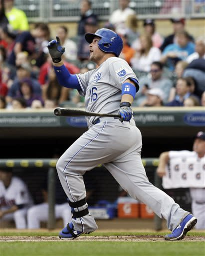 Kansas City Royals' Billy Butler watches his three-run home run off Minnesota Twins pitcher P.J. Walters in the first inning of a baseball game Friday, June 28, 2013, in Minneapolis. (AP Photo/Jim Mone)