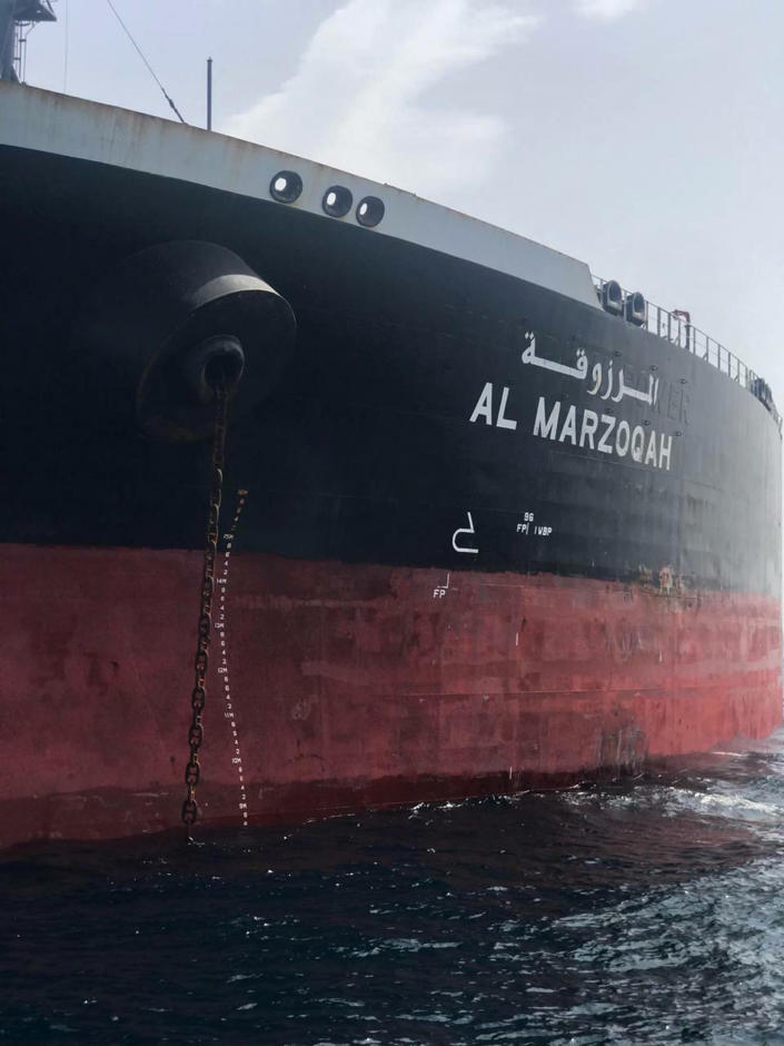 """This photo provided by the United Arab Emirates' National Media Council shows the Saudi-flagged oil tanker Al Marzoqah off the coast of Fujairah, United Arab Emirates, Monday, May 13, 2019. Two Saudi oil tankers and a Norwegian-flagged vessel were damaged in what Gulf officials described Monday as a """"sabotage"""" attack off the coast of the United Arab Emirates. While details of the incident remain unclear, it raised risks for shippers in a region vital to global energy supplies at a time of increasing tensions between the U.S. and Iran over its unraveling nuclear deal with world powers. (United Arab Emirates National Media Council via AP)"""