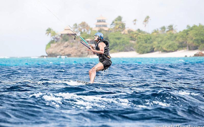 Former President of the United States Barack Obama learning to kitesurf on the British Virgin Islands after he finished his second term as President, February 2017 - Credit: PA