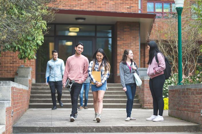 """<span class=""""caption"""">Latinx students majoring in business are underrepresented in higher education.</span> <span class=""""attribution""""><a class=""""link rapid-noclick-resp"""" href=""""https://www.gettyimages.com/detail/photo/two-ethnic-college-friends-leave-class-together-and-royalty-free-image/900413292?adppopup=true"""" rel=""""nofollow noopener"""" target=""""_blank"""" data-ylk=""""slk:FatCamera/GettyImages"""">FatCamera/GettyImages</a></span>"""