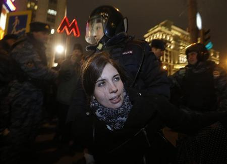 Pussy Riot member Tolokonnikova is detained by police at a protest in central Moscow