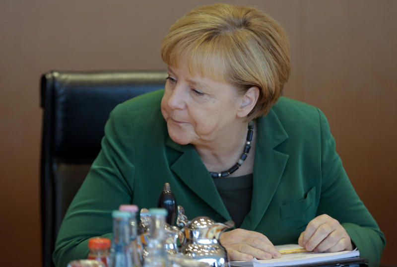 German Chancellor Angela Merkel attends the last cabinet meeting prior to the national elections at the chancellery in Berlin, Wednesday, Sept. 18, 2013. Germany faces general elections on Sept. 22, 2013 where Chancellor and Christian Democratic Union, CDU, party chairwoman Merkel will run for her third term . (AP Photo/Markus Schreiber)