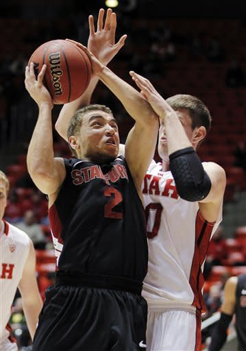 Stanford guard Aaron Bright (2) shoots against Utah forward Renan Lenz, right, during the first half of an NCAA college basketball game, Sunday, Jan. 27, 2013, in Salt Lake City. (AP Photo/Steve C. Wilson)
