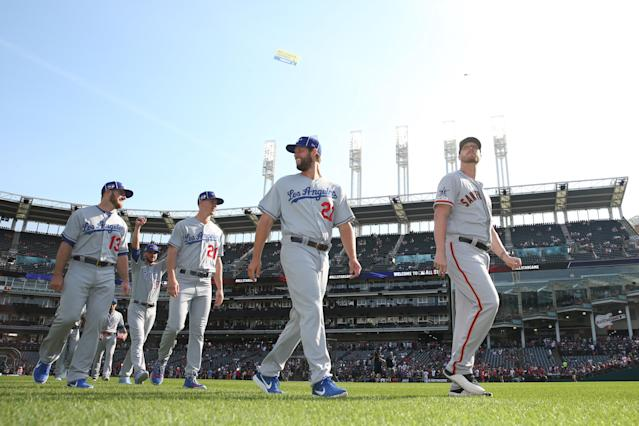 Clayton Kershaw #22 of the Los Angeles Dodgers, Will Smith #13 of the San Francisco Giants are seen on the field prior to the 90th MLB All-Star Game at Progressive Field on Tuesday, July 9, 2019 in Cleveland, Ohio. (Photo by Rob Tringali/MLB Photos via Getty Images)