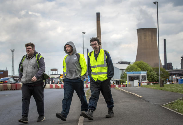 Workers leave the steelworks plant in Scunthorpe following a shift change as owner British Steel is to go into official recievership after failing to secure funds for its future. Photo: Press Association