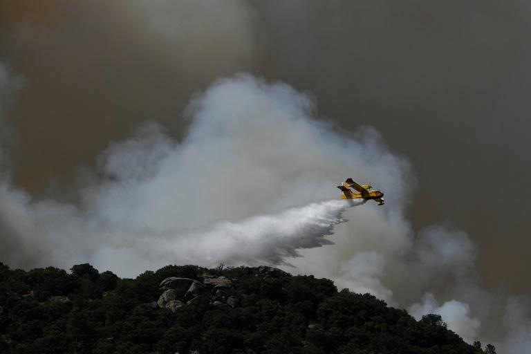 Firefighters in Spain battled high flames in strong winds and blistering heat just after they managed to contain another inferno after nearly 72 hours. (AFP Photo/PIERRE-PHILIPPE MARCOU)