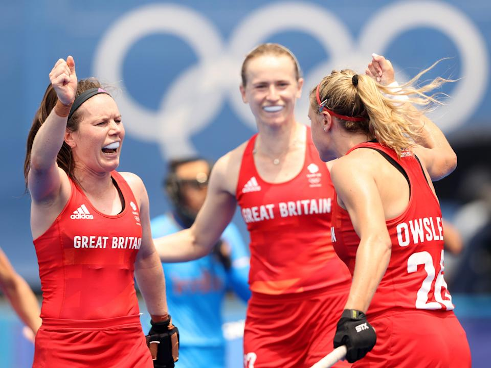 Lily Owsley of Team Great Britain celebrates scoring the third goal with Laura Unsworth during the Women's Preliminary Pool A match between Great Britain and India on day five of the Tokyo 2020 Olympic Games (Getty Images)
