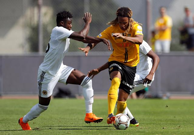 Soccer Football - Uhrencup - BSC Young Boys v Wolverhampton Wanderers - Stadion Neufeld, Bern, Switzerland - July 14, 2018 Young Boys' Kevin Mbabu in action with Wolverhampton Wanderers' Bright Enobakhare REUTERS/Stefan Wermuth