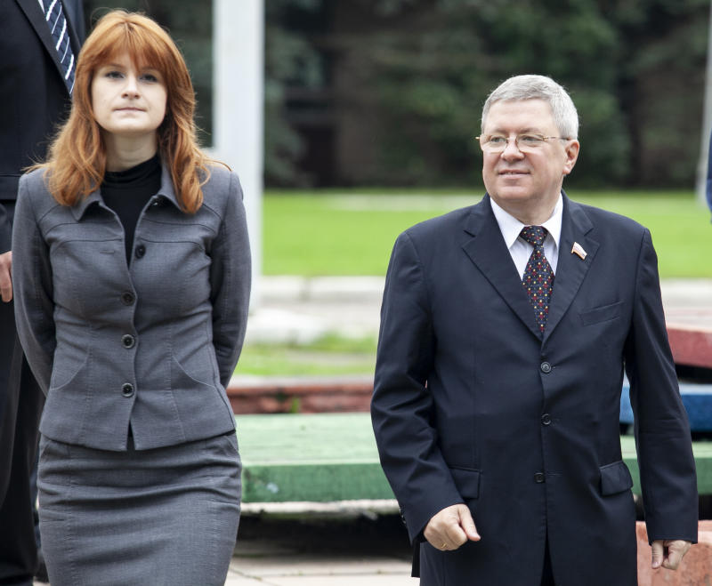 Maria Butina walks with Alexander Torshin then a member of the Russian upper house of parliament in Moscow, Russia. (Photo: AP Photo/Pavel Ptitsin, File)