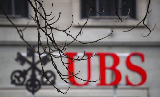 Swiss banking giant UBS's net profit slid by 54% to $910 million in the first quarter of 2012