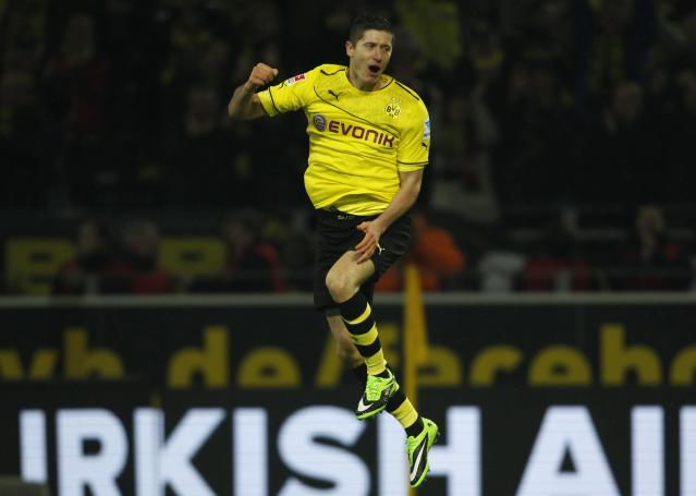 Borussia Dortmund's Robert Lewandowski celebrates a goal against Stuttgart during the German first division Bundesliga soccer match in Dortmund November 1, 2013. REUTERS/Ina Fassbender (GERMANY - Tags: SPORT SOCCER) DFL RULES TO LIMIT THE ONLINE USAGE DURING MATCH TIME TO 15 PICTURES PER GAME. IMAGE SEQUENCES TO SIMULATE VIDEO IS NOT ALLOWED AT ANY TIME. FOR FURTHER QUERIES PLEASE CONTACT DFL DIRECTLY AT + 49 69 650050