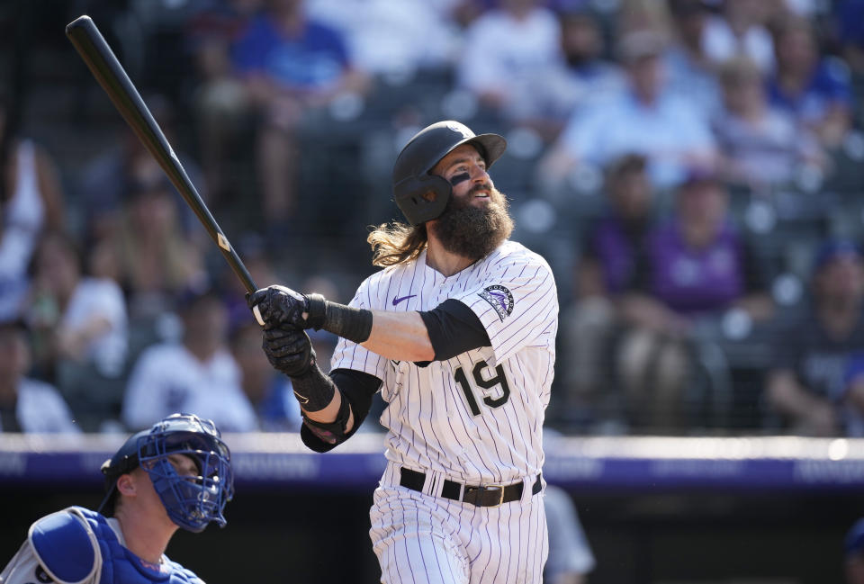 Colorado Rockies' Charlie Blackmon follows the flight of his solo walkoff home run off Los Angeles Dodgers starting pitcher Phil Bickford in the 10th inning of a baseball game Sunday, July 18, 2021, in Denver. (AP Photo/David Zalubowski)