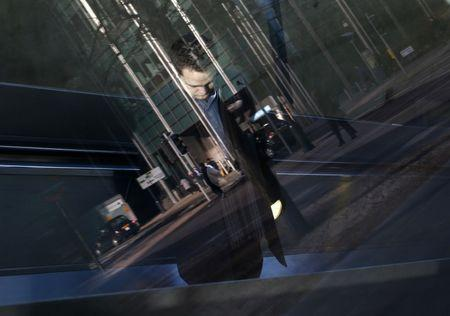 A worker travels up the escalator from the underground station in the Canary Wharf business district in London