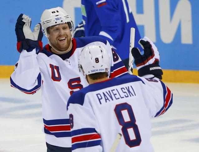Team USA's Phil Kessel is congratulated by teammate Joe Pavelski after scoring on Slovenia during the first period of their men's preliminary round ice hockey game at the 2014 Sochi Winter Olympics, February 16, 2014. REUTERS/Brian Snyder (RUSSIA - Tags: OLYMPICS SPORT ICE HOCKEY TPX IMAGES OF THE DAY)