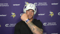 This photo taken Aug. 5, 2020, during a Zoom interview with reporters, Vikings tight end Kyle Rudolph, displays the proximity tracking device that players and staff around the NFL are wearing at team facilities as part of COVID-19 protocols.