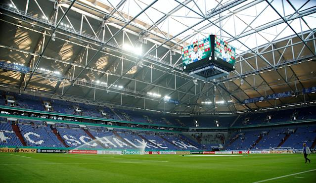 Soccer Football -DFB Cup - Schalke 04 vs Eintracht Frankfurt - Veltins-Arena, Gelsenkirchen, Germany - April 18, 2018 General view inside the stadium before the match REUTERS/Leon Kuegeler DFB RULES PROHIBIT USE IN MMS SERVICES VIA HANDHELD DEVICES UNTIL TWO HOURS AFTER A MATCH AND ANY USAGE ON INTERNET OR ONLINE MEDIA SIMULATING VIDEO FOOTAGE DURING THE MATCH.