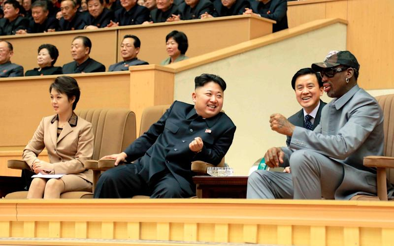 Kim Jong Un and Dennis Rodman watch a basketball game between former U.S. NBA basketball players and North Korean players in Pyongyang in 2014 - Reuters