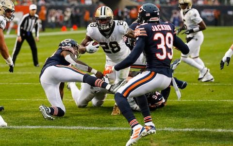 New Orleans Saints running back Latavius Murray (28) dives in for a touchdown between Chicago Bears inside linebacker Danny Trevathan (59) and free safety Eddie Jackson (39) during the second half of an NFL football game in Chicago - Credit: AP