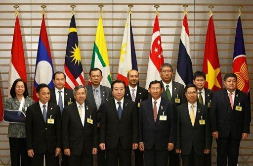 """Japan's Prime Minister Yoshihiko Noda (front C) and economic ministers from members of the Association of Southeast Asian Nations (ASEAN) pose for a photograph at the start of their meeting as part of a four-day """"ASEAN Road Show"""" at Noda's official residence in Tokyo. Southeast Asian and European foreign ministers meet in Brunei on Friday to chart a """"new chapter"""" in their relations"""