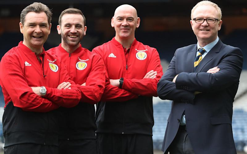 Alex McLeish, right, poses with his assistant coaches Peter Grant, James McFadden and Stevie Woods at Hampden at the start of his second spell as Scotland manager - Getty Images Europe