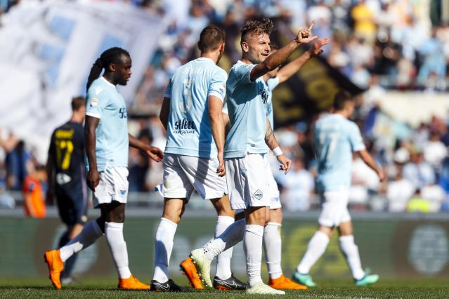 Lazio's Ciro Immobile, center, celebrates with his teammates after scoring during the Serie A soccer match between Lazio and Sampdoria at the Rome Olympic stadium Sunday, April 22, 2018. (Angelo Carconi/ANSA via AP)