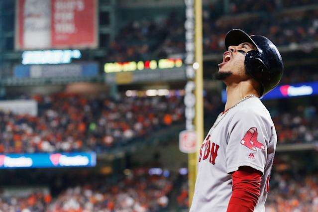 Boston Red Sox outfielder Mookie Betts celebrates after Jackie Bradley Jr. hit a two-run home run in the sixth inning against the Houston Astros. (Getty Images)