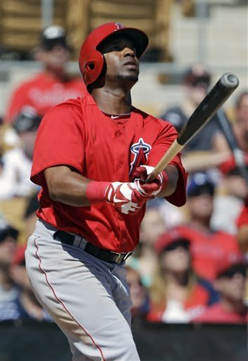 Los Angeles Angels' Alberto Callaspo watches his two-run home run off Chicago White Sox starting pitcher Gavin Floyd in the third inning of an exhibition spring training baseball game Monday, March 25, 2013, in Glendale, Ariz. The Angels won 11-5. (AP Photo/Mark Duncan)