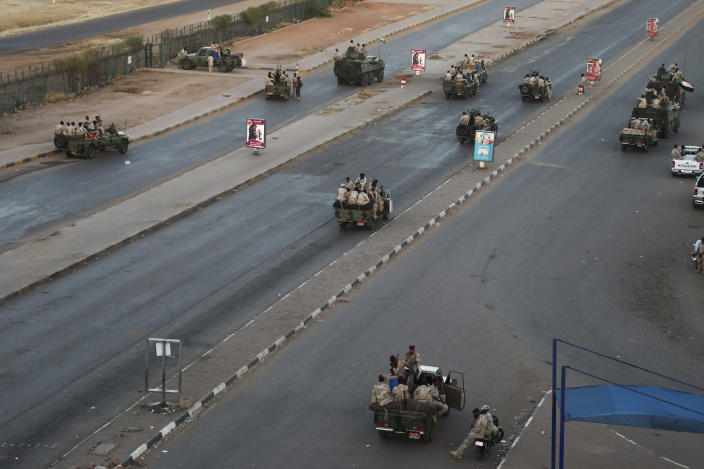 Members of the Rapid Support Forces, a paramilitary force operated by the Sudanese government, block roads in Khartoum, Sudan, Tuesday, Jan. 14, 2020. A Sudanese official said Tuesday that security forces have contained an armed protest from within the security apparatus, amid reports of unrest. (AP Photo)