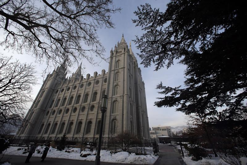The Salt lake Temple is shown Wednesday, Jan. 9, 2013, in Salt Lake City. Utah's most-visited landmark, the granite-towered Temple Square invokes the mystery of Mormonism. The 35-acre square is the worldwide headquarters of The Church of Jesus Christ of Latter-day Saints, and features the church's sacred temple, one of the world's largest genealogy libraries and spectacular gardens. The square is open every day of the year from 9 a.m. - 9 p.m., and free tours are available in 30 different languages. (AP Photo/Rick Bowmer)