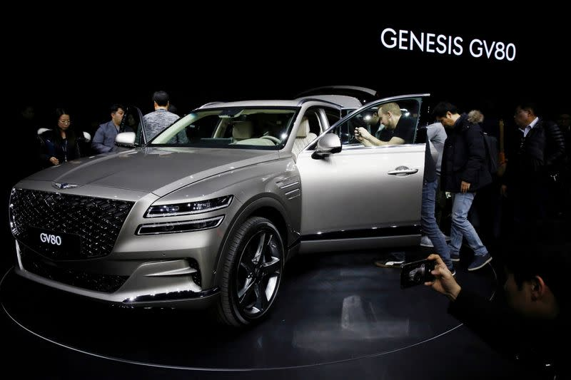 FILE PHOTO: Visitors take a look around Hyundai Motor Genesis GV80 SUV during its unveiling ceremony in Goyang