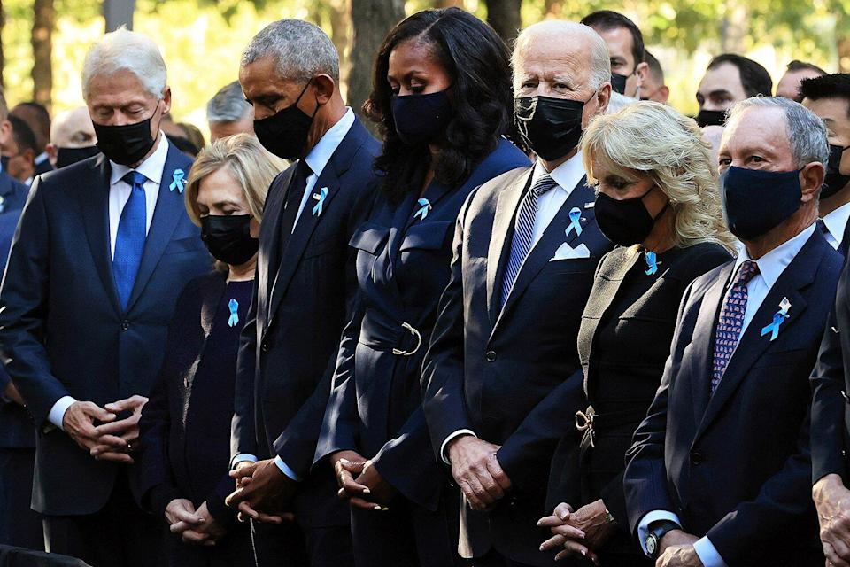 (L-R) Former President Bill Clinton, former First Lady Hillary Clinton, former President Barack Obama, former First Lady Michelle Obama, President Joe Biden, First Lady Jill Biden, former New York City Mayor Michael Bloomberg, Bloomberg's partner Diana Taylor and Speaker of the House Nancy Pelosi (D-CA) participate in a moment of silence during the annual 9/11 Commemoration Ceremony at the National 9/11 Memorial and Museum on September 11, 2021 in New York.