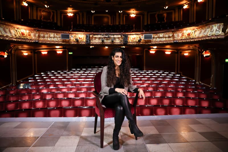 Actress Sejal Keshwala poses onstage inside the Apollo Theatre on Shaftsbury Avenue, in London
