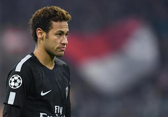 "Paris Saint-Germain's Neymar flew home to Brazil for three days because of a ""family problem"" and returned to France on December 13, 2017 (AFP Photo/Christof STACHE)"