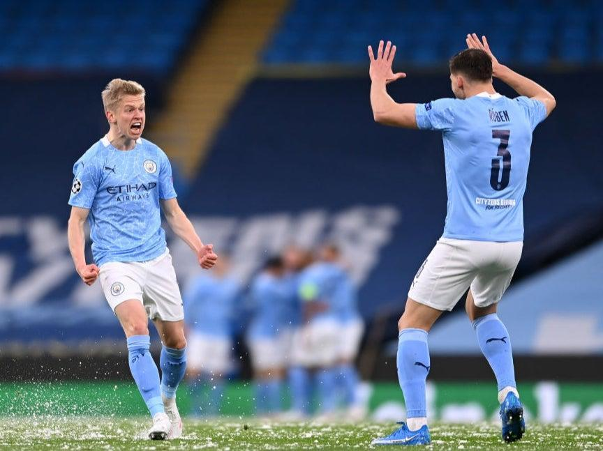 Defenders Oleksandr Zinchenko and Ruben Dias celebrate (Getty Images)