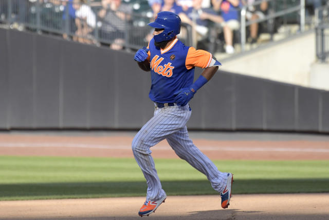 New York Mets' Amed Rosario rounds the bases with a home run during the sixth inning of a baseball game against the New York Mets, Saturday, Aug. 25, 2018, in New York. (AP Photo/Bill Kostroun)